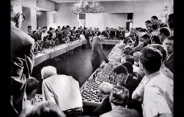 1964 U.S. chess prodigy Bobby Fisher playing 50 opponents at once. He won 47, lost 1, and drew 2